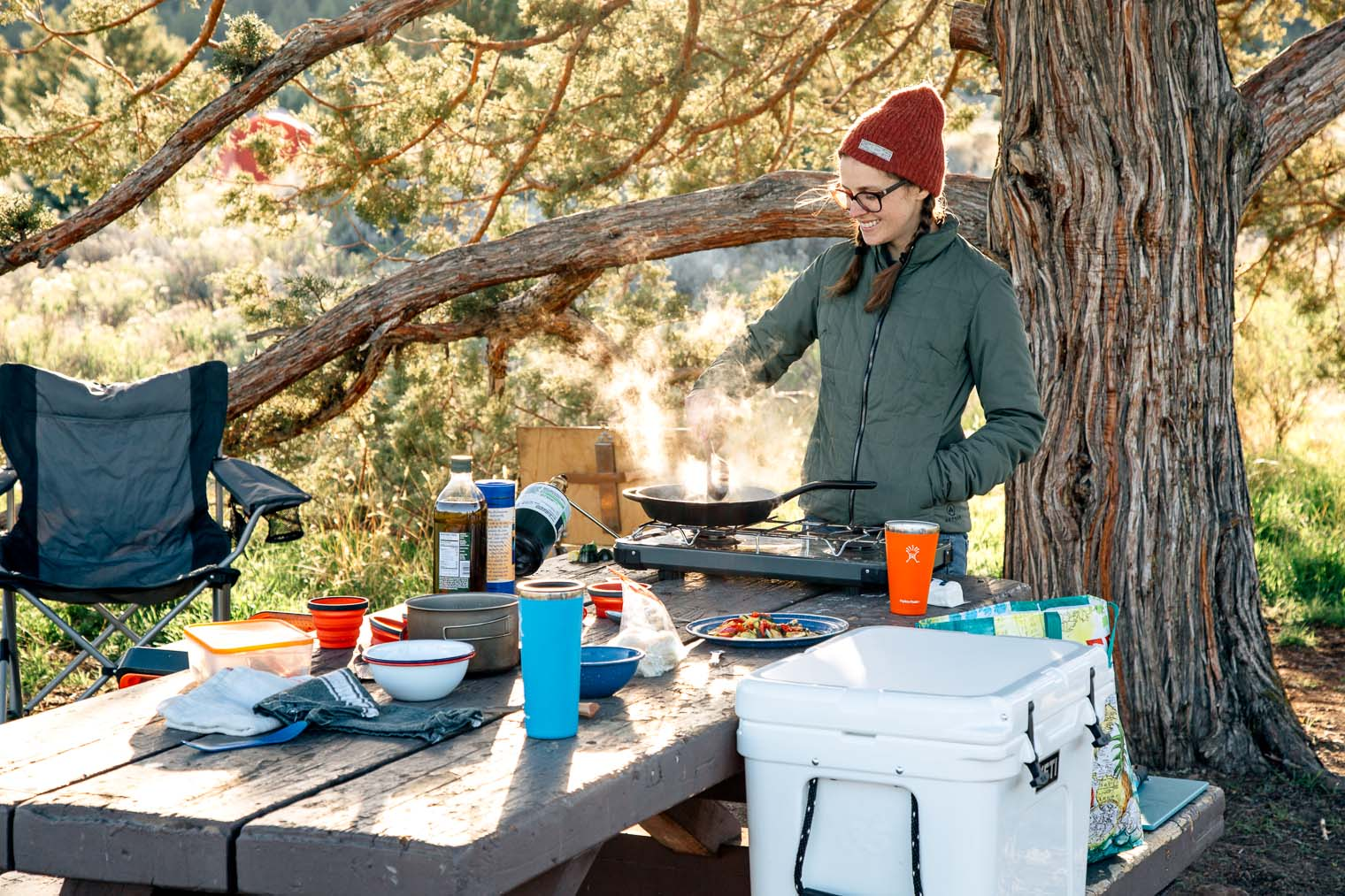 Camping Kitchen Essentials: What gear you need to cook while car camping? This camp kitchen checklist has all the details!