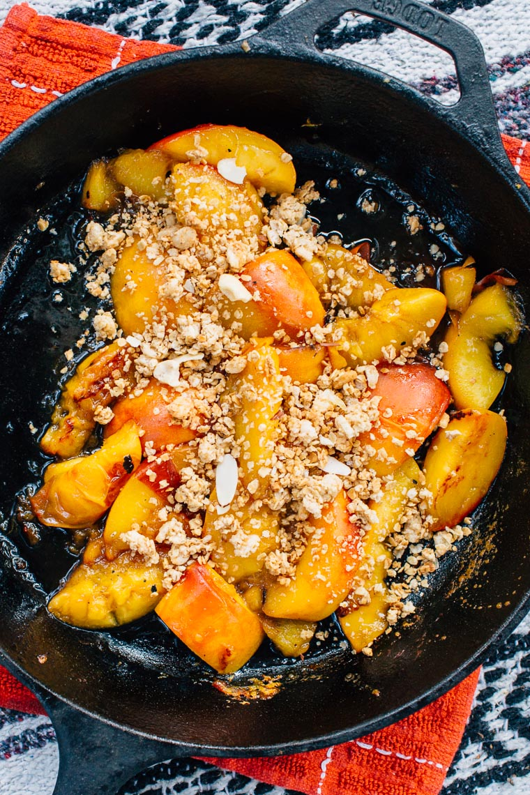 An easy camping dessert: Peach Cobbler with Brown Sugar Bourbon Sauce. Made right on your campfire - no oven required!