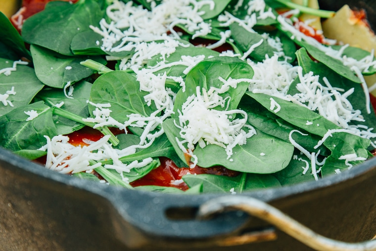 The secret to making lasagna over a campfire? A dutch oven and fresh pasta! Learn how with this recipe for vegetarian spinach & cheese campfire lasagna.