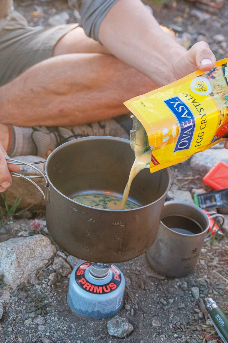 An easy backpacking meal idea: Scrambled eggs with sun-dried peppers and spinach. With just a few ingredients (and no dehydrator!) you can make this backpacking breakfast ahead of time and enjoy a homemade meal on the trail.