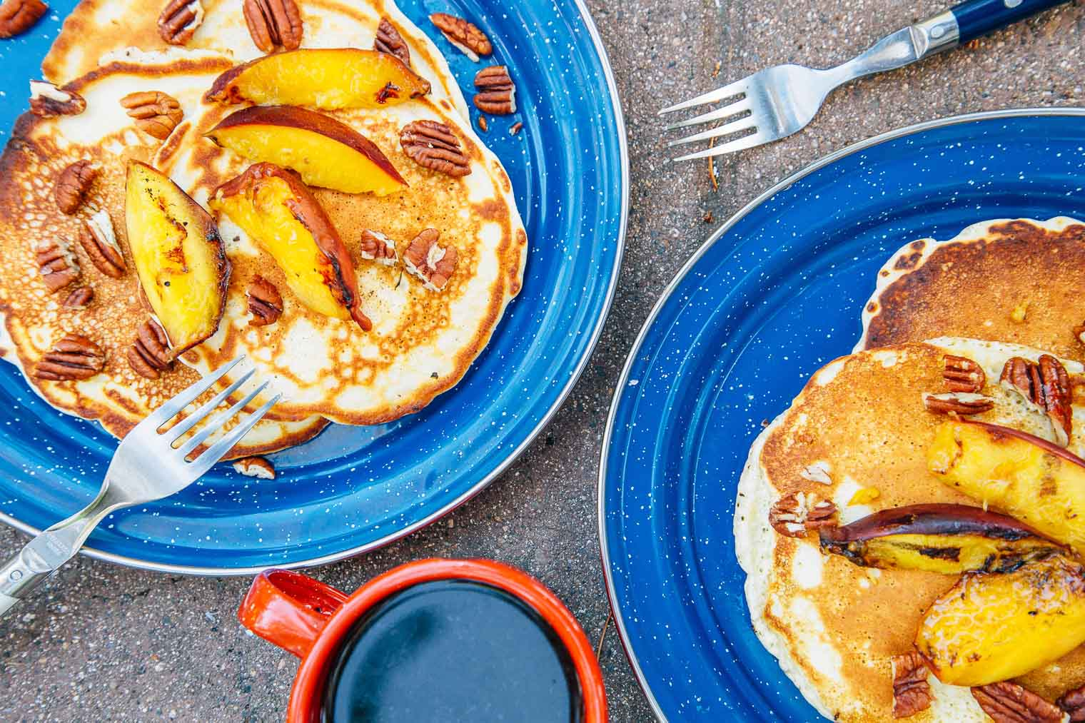 An easy twist on the camp breakfast classic, these pancakes are topped with grilled peaches and chopped pecans.