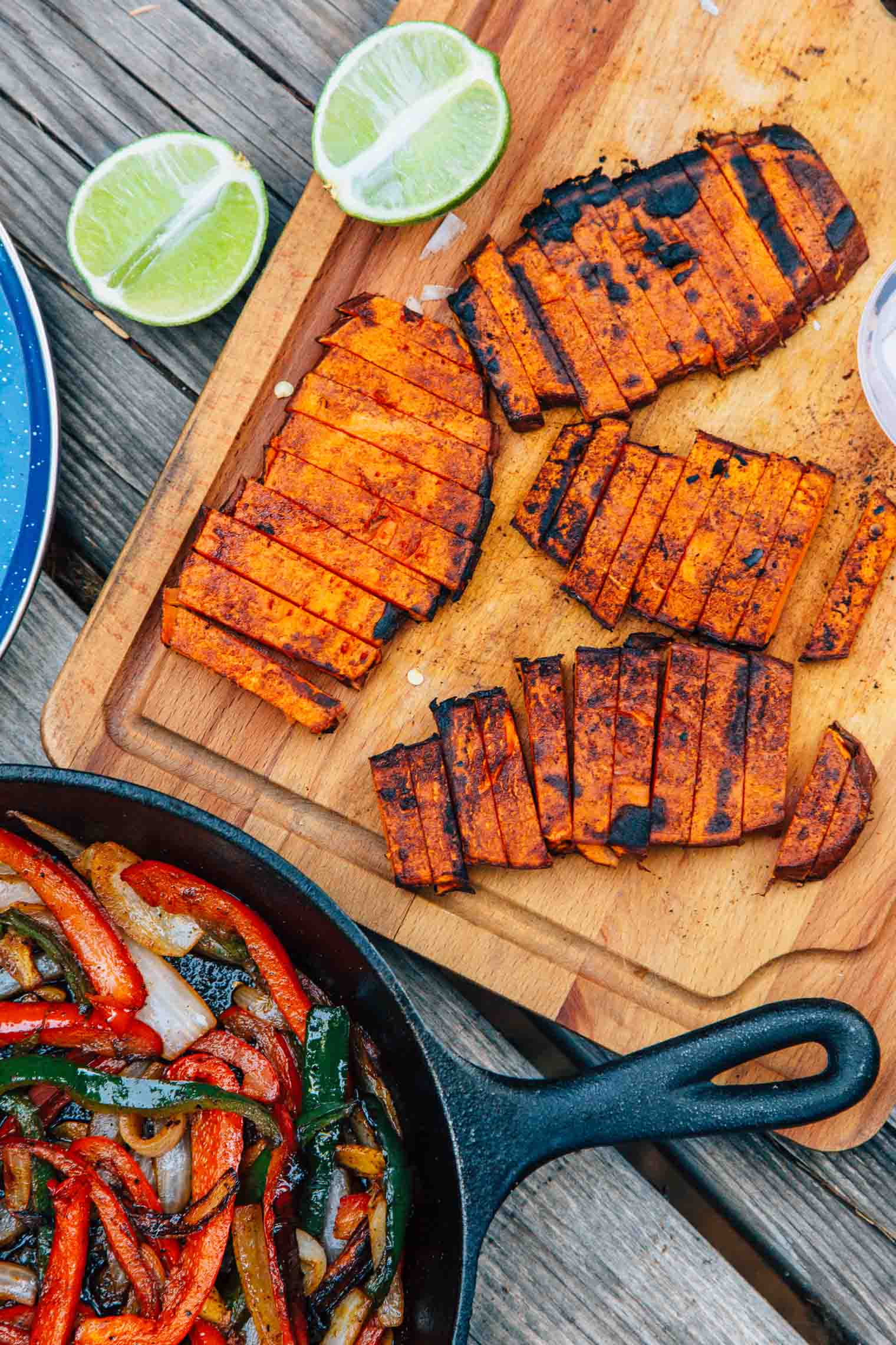 """Grilled sweet potato """"steaks"""", roasted peppers and onions, and a New Mexican chile marinade, these vegan campfire fajitas are a new take on an old classic."""