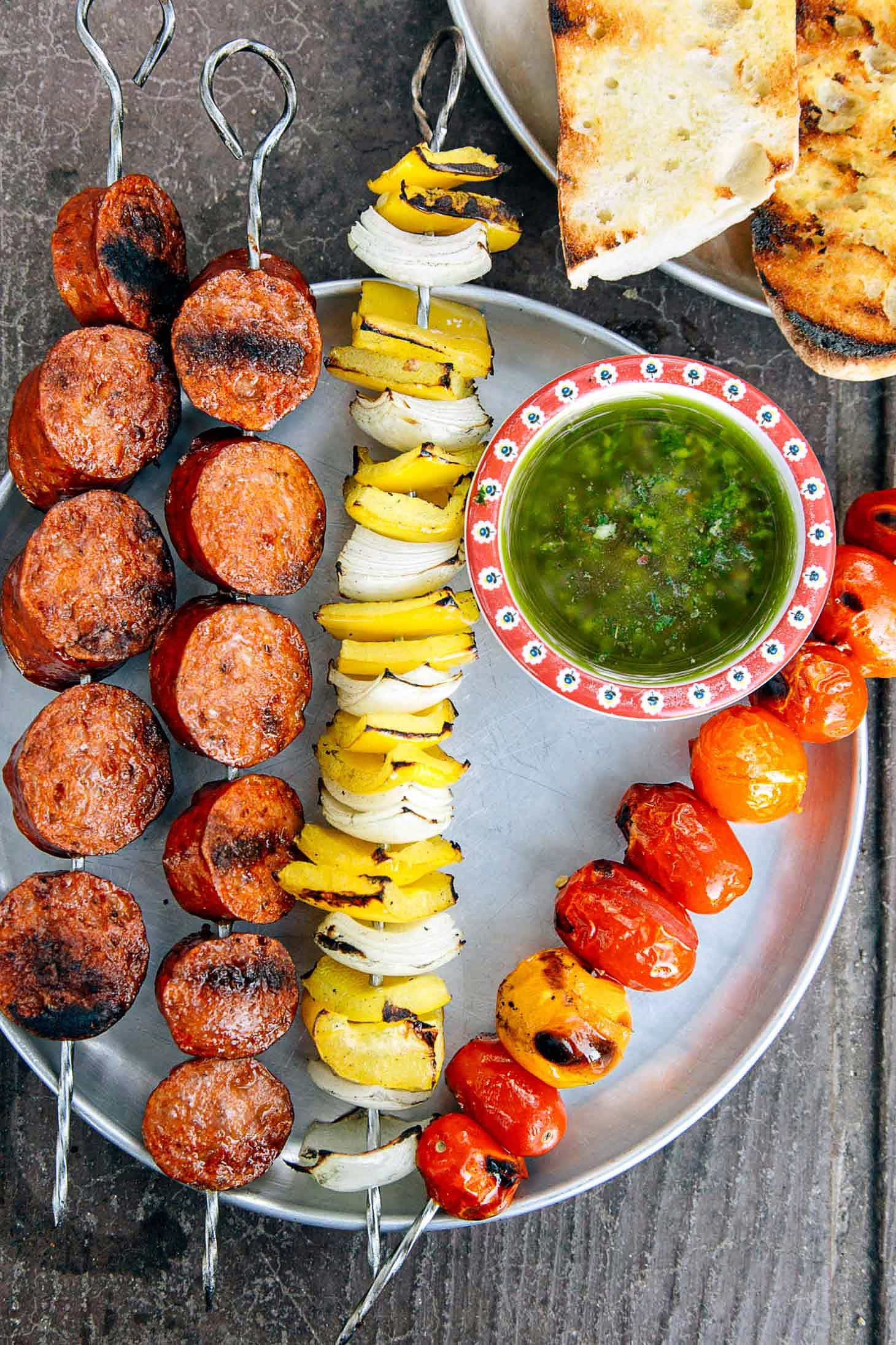 Grilled Chorizo Kebabs on a silver camping plate.