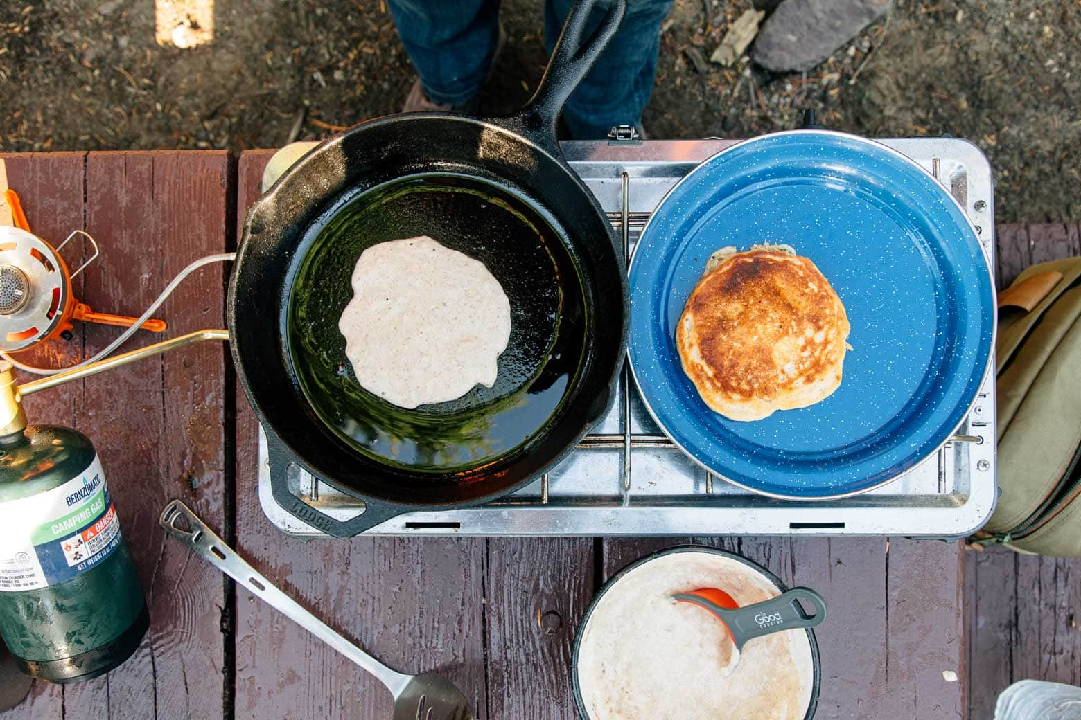 Spiced Pumpkin Pancakes cooking on a camping stove