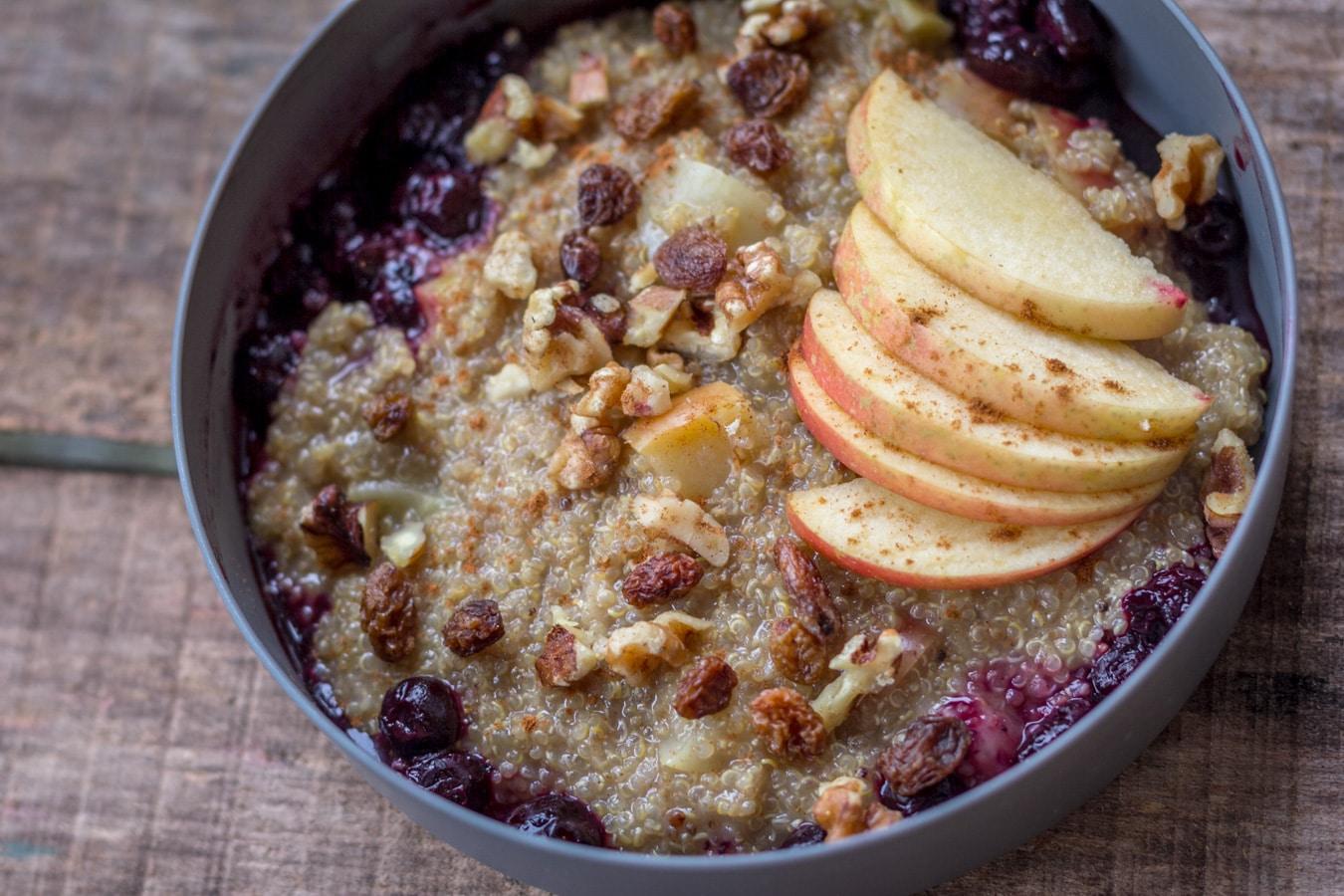 Bowl of quinoa porridge with apples.