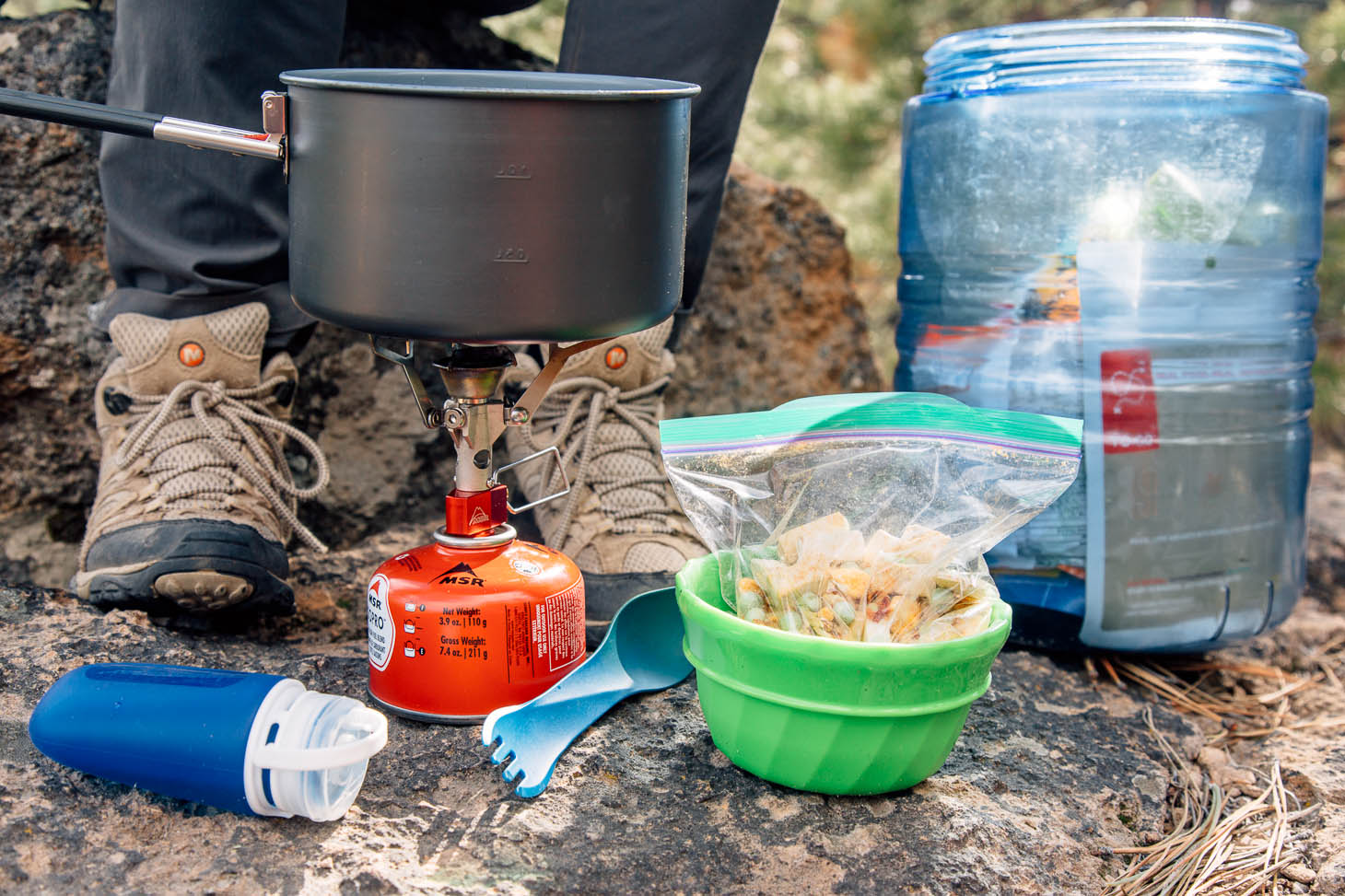 Ingredients and supplies to cook red curry rice while backpacking.